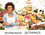 female stall holder at farmers... | Shutterstock . vector #267549425