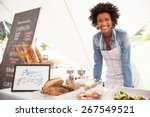 female bakery stall holder at... | Shutterstock . vector #267549521