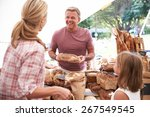 Family Buying Bread From Baker...