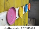 colorful plates on wooden wall | Shutterstock . vector #267581681