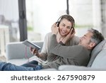 mature couple at home listening ...   Shutterstock . vector #267590879