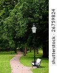 Park alley with white benches in summer, Estonia. - stock photo