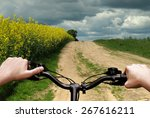 bike riding on a dirt road. the ... | Shutterstock . vector #267616211