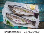 Two Raw Trouts On Paper With...