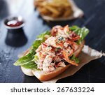 lobster roll on slate surface | Shutterstock . vector #267633224
