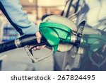 pumping gas at gas station.... | Shutterstock . vector #267824495