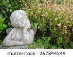 Weathered Statue Of An Infant...