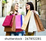 two smiling girls with shopping ...   Shutterstock . vector #267852281