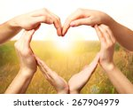 Heart Shaped By Hands On Natur...