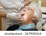 female dentist and her patient  ... | Shutterstock . vector #267905414