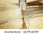 a lonely girl is walking along... | Shutterstock . vector #267916559