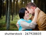 happy couple embracing in a... | Shutterstock . vector #267928835