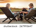 senior couple sitting on chairs ... | Shutterstock . vector #267993647