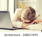 Small photo of picture of tired woman with laptop computer