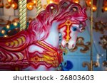 Small photo of Red carousal horse on a carnival merry-go-round.