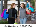 Mother and daughter on a shopping trip together in the city. - stock photo