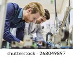 two young handsome engineers... | Shutterstock . vector #268049897