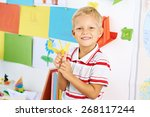 portrait of happy schoolboy... | Shutterstock . vector #268117244