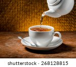 tea being poured into tea cup | Shutterstock . vector #268128815