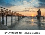 wooden pier and lighthouse in... | Shutterstock . vector #268136081