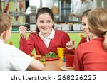 group of pupils sitting at...   Shutterstock . vector #268226225