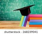 graduation  mortar board  book. | Shutterstock . vector #268239041
