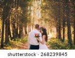 happy bride and groom walking...   Shutterstock . vector #268239845