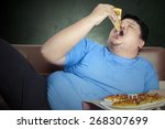 Obese Person Eats Pizza While...