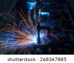 robots welding in a car factory | Shutterstock . vector #268367885