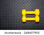 yellow dumbbells on a black... | Shutterstock . vector #268407905