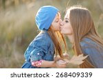 portrait of mother and daughter ... | Shutterstock . vector #268409339