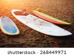 surfboards lying on the beach... | Shutterstock . vector #268449971