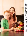 mother and child in the kitchen | Shutterstock . vector #268471397