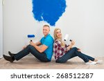 young couple sitting with back... | Shutterstock . vector #268512287