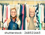Постер, плакат: Playful senior couple at