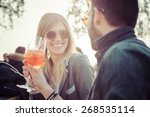 beautiful couple  toasting at... | Shutterstock . vector #268535114