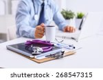 male doctor sitting at his desk | Shutterstock . vector #268547315