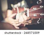 playing ukulele close up.... | Shutterstock . vector #268571009