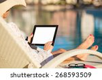 woman using tablet computer by...   Shutterstock . vector #268593509
