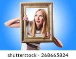 woman with picture frame on... | Shutterstock . vector #268665824