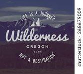vector wilderness emblem.... | Shutterstock .eps vector #268679009