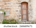 Ancient Stone Wall With Wooden...