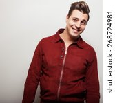 Small photo of Elegant young handsome man in claret suede jacket. Studio fashion portrait.