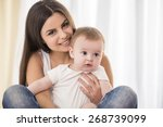 portrait of happy mother with... | Shutterstock . vector #268739099