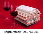 glass of wine and books on a... | Shutterstock . vector #268761251