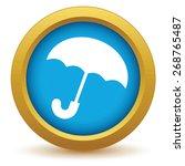 gold umbrella icon on a white...