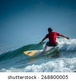 surfer riding the wave on the... | Shutterstock . vector #268800005