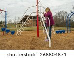 girl on playground equipment. | Shutterstock . vector #268804871