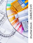 rolled blueprints and paint... | Shutterstock . vector #268825145