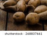 Raw Potatoes  On Wood Hard...